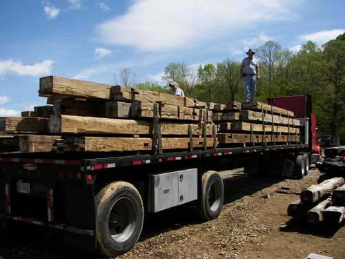 Flatbed truck loaded with reclaimed wood beams