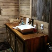 Reclaimed wood walls and vanity