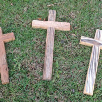 Reclaimed wood crosses laying on grass