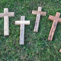 Group of reclaimed wood crosses laying on grass