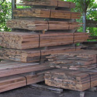 Stacks of reclaimed wood boards